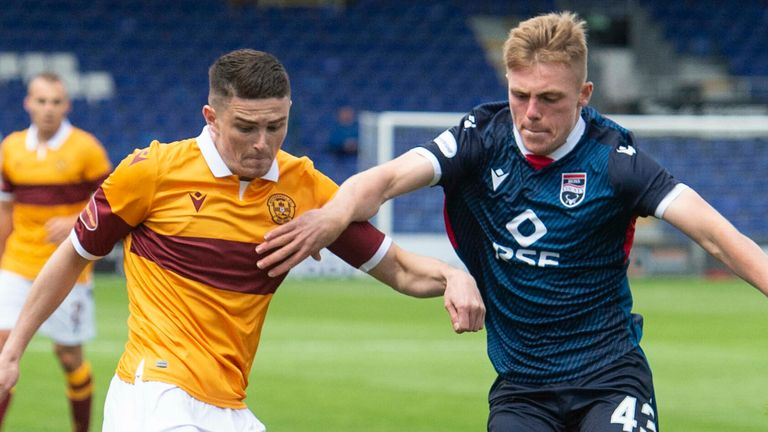 Motherwell's Jake Hastie competes with Ross County's Josh Reid